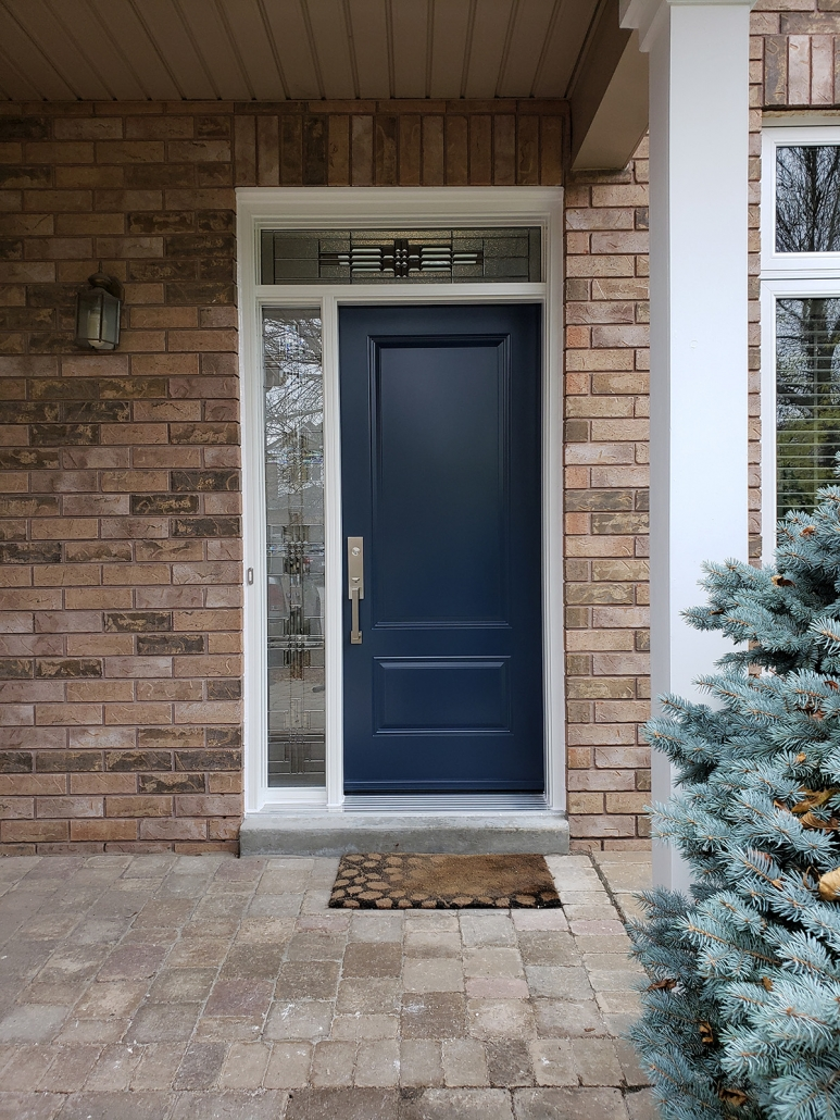 2 panel steel door painted blue, white frame with all glass transom and sidelite installed by Simon and Sons Newmarket, Aurora, King City