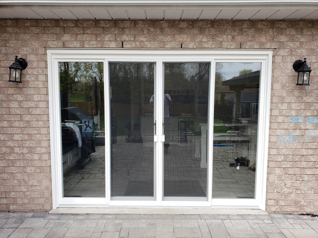 Vinyl patio door with new screen installed in Aurora