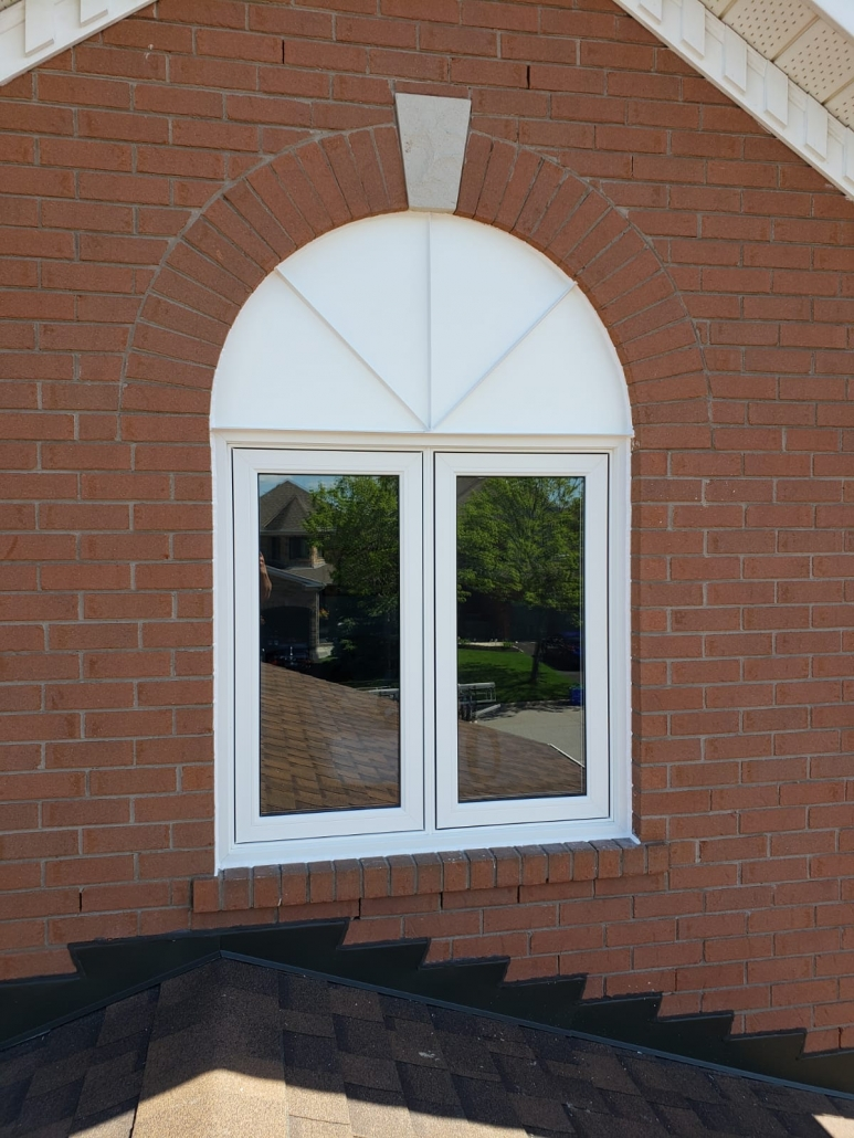 2 panel casement window installed in Aurora above garage with sunburst aluminum capping by Simon and Sons Windows & Doors