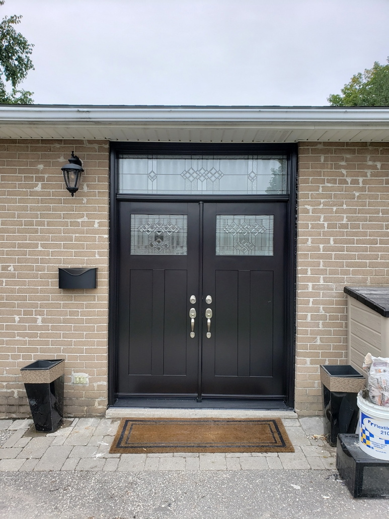 Fiberglass smooth craftsman door with decorative glass in door and transom