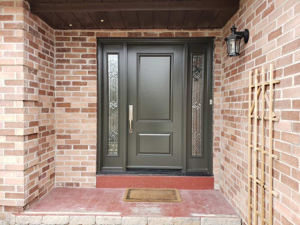 Fiberglass door commercial brown with sidelites and Emtek hardware installed in Newmarket