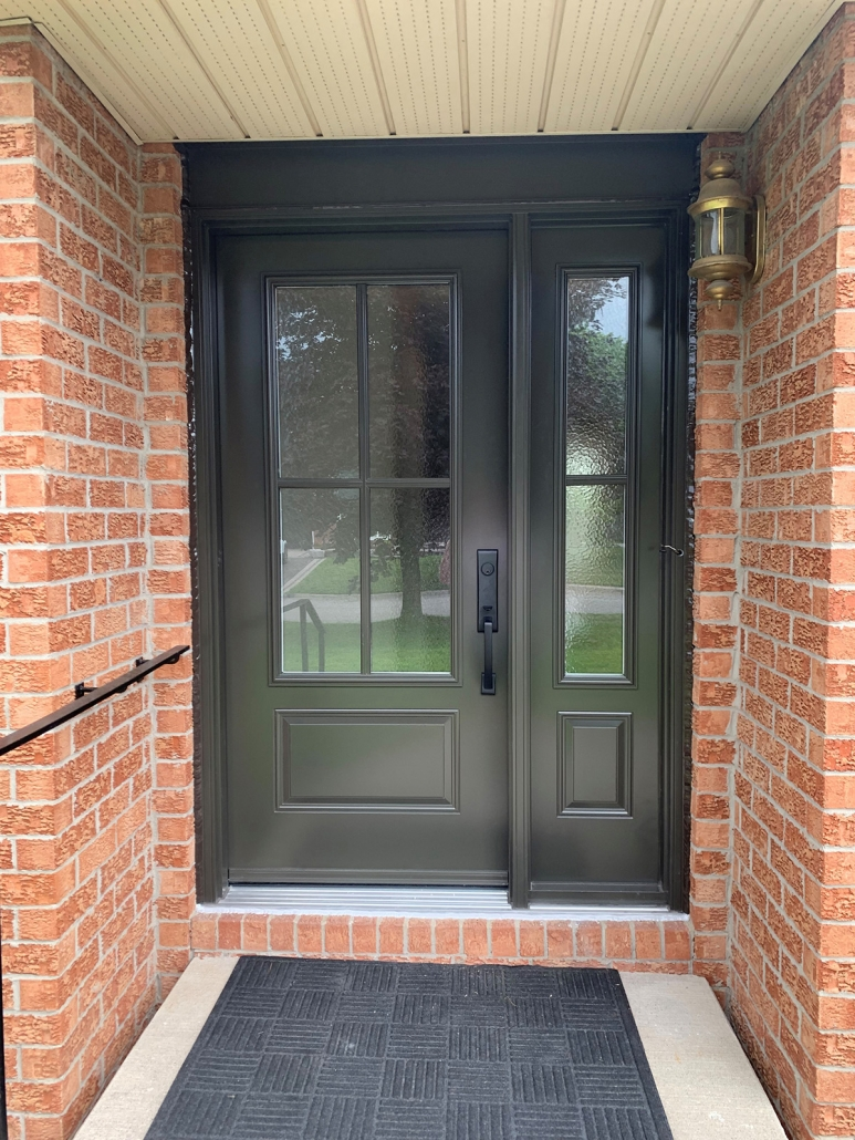 Steel door and sidellite with simple aluminum grills between glass installed in Holland Landing