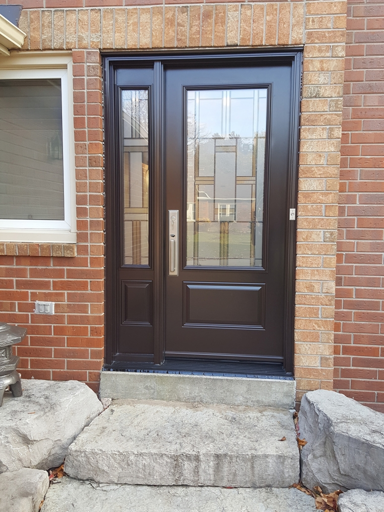 Front door and sidelite with privacy glass and Emtek hardware installed in Georgina