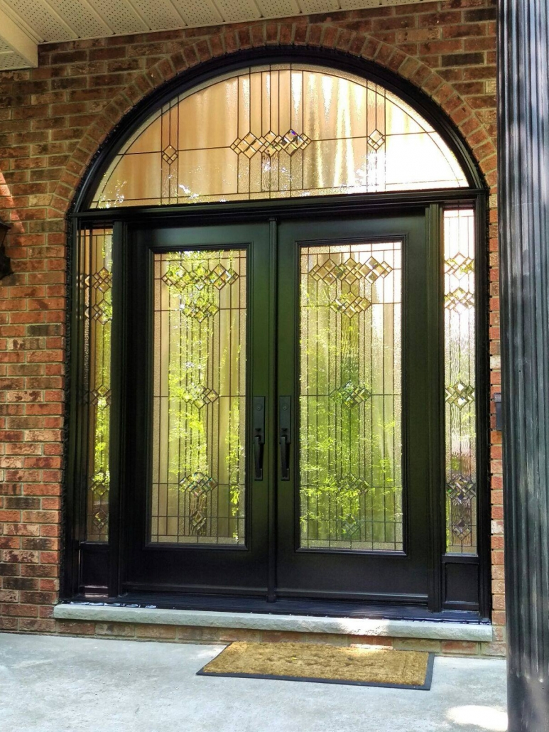 Double doors with side panels and transom with fancy glass installed in Newmarket