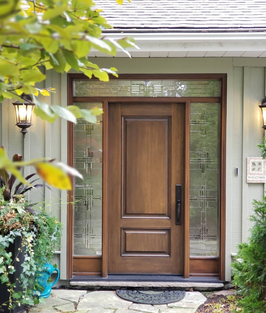 Elegant front door with mahogany woodgrain and decorative glass installed in King City home