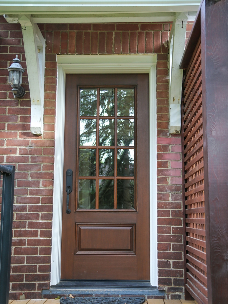 New fiberglass door installed in Newmarket century home with SDL grills and hand stained