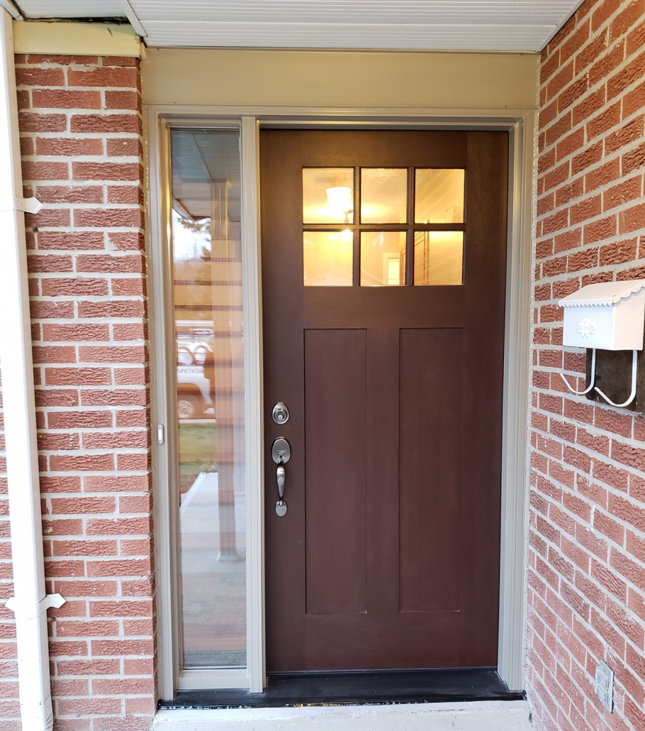 Fiberglass Craftsman door with shaker style look and SDL grills with one sidelite installed in Newmarket