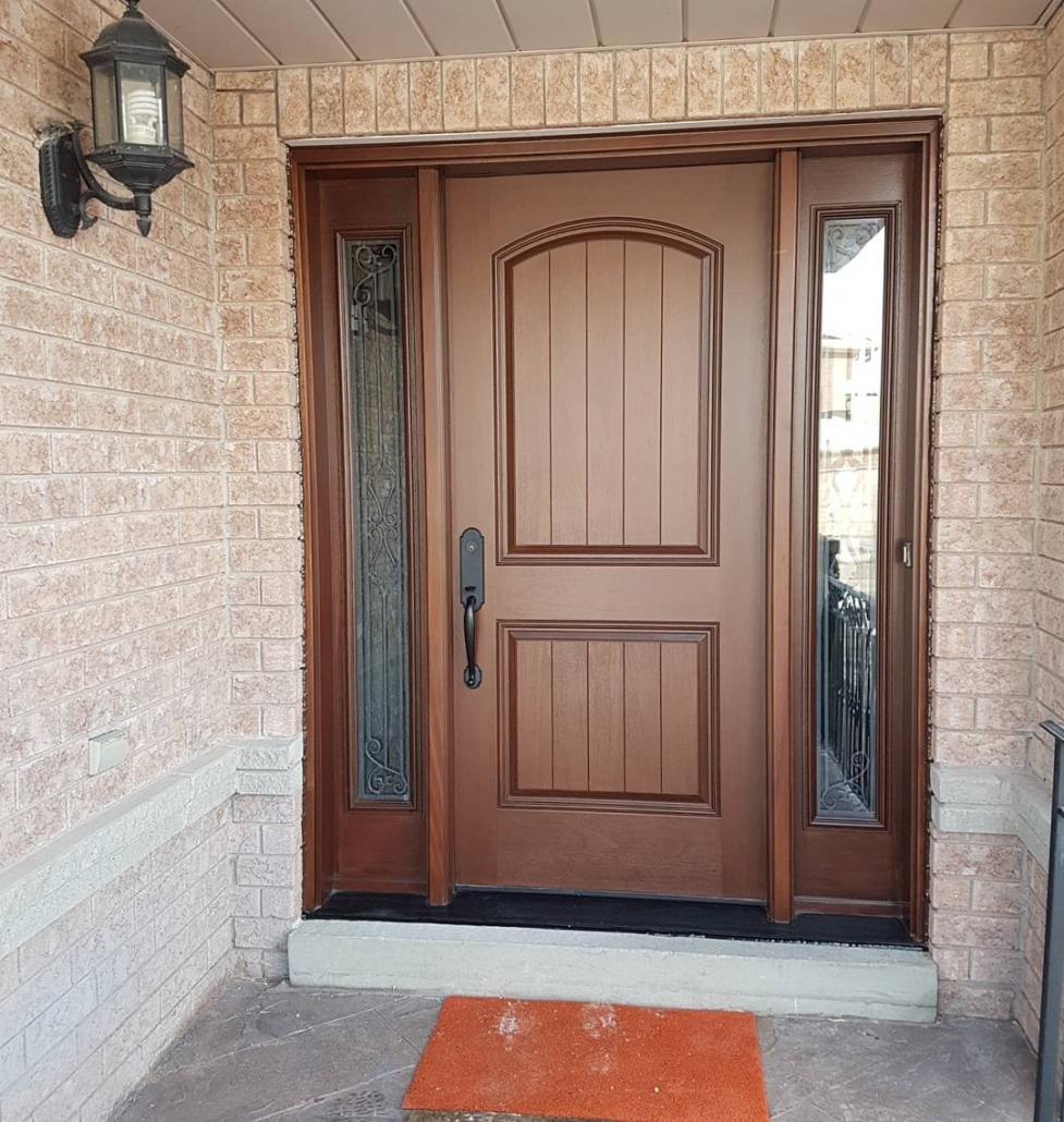 Solid wood frame with fiberglass mahogany door and sidelites installed by professionals in Newmarket