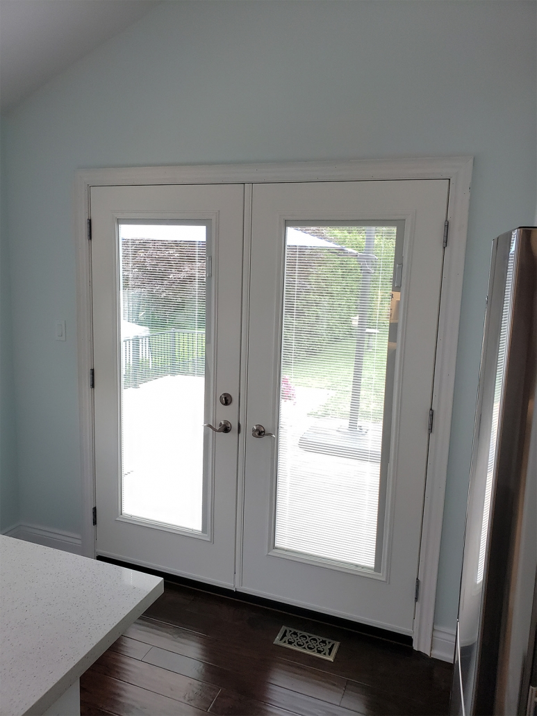 Garden door with mini blinds between the glass installed in Aurora