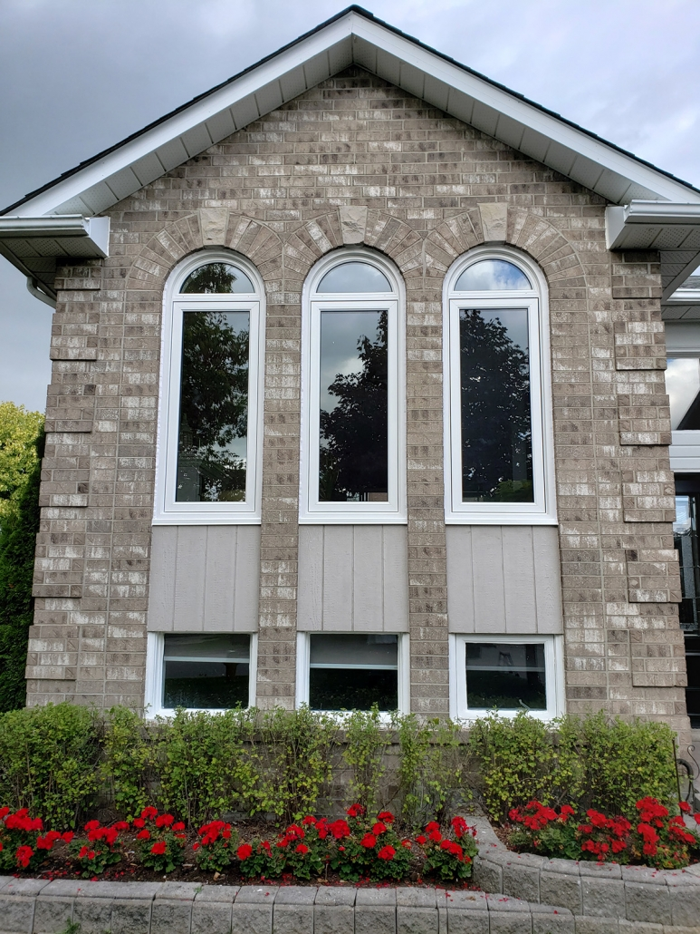 Half round shaped energy efficient windows installed in Sharon with brickmould