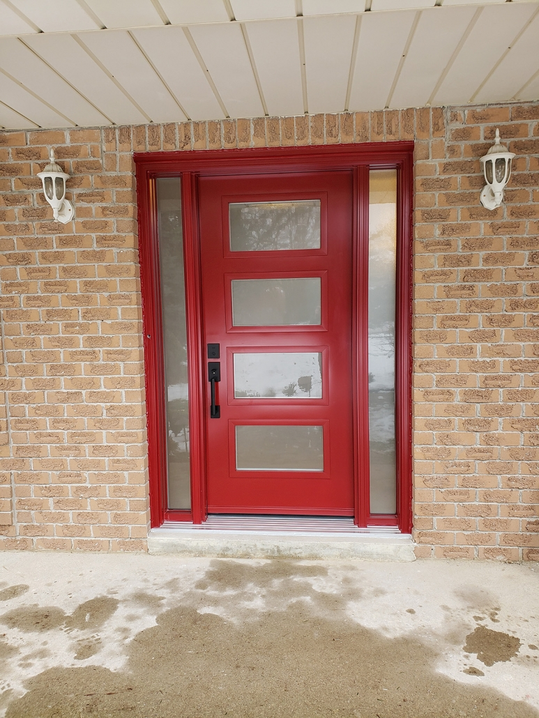 Modern door with 4 glass panels and all glass sidelites installed in Sharon