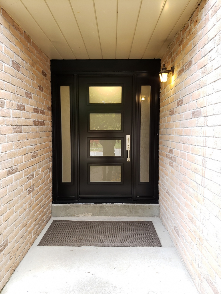 Elegant and energy efficient front door with sidelites new frame and hardware installed in Newmarket