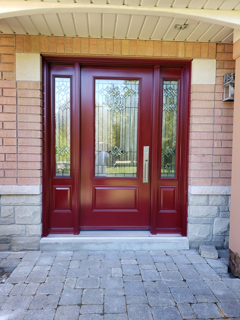 Front door and 2 sidelites with matching decorative glass painted red with Emtek hardware installed in Sharon