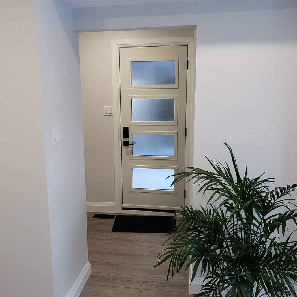 Modern door at side of Newmarket home with modern casing and electronic keypad