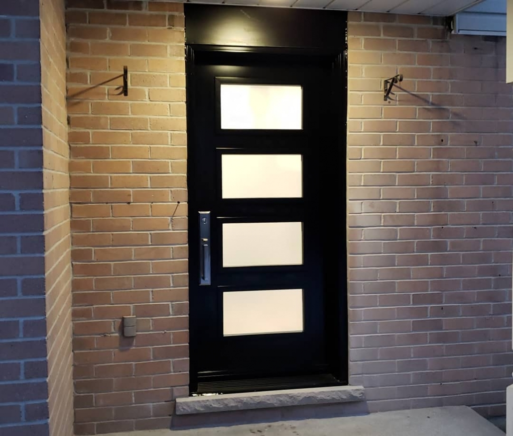 Energy efficient modern front door with 4 glass panels painted black installed in Newmarket