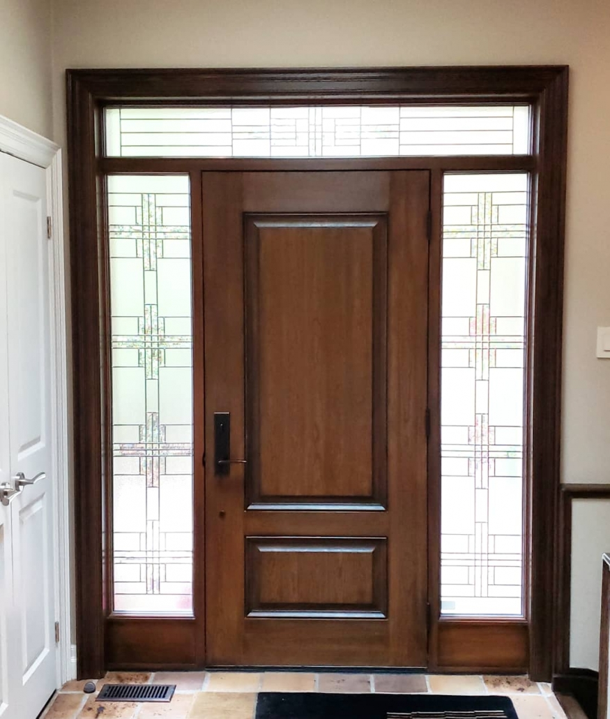 Front door with solid wood frame and fiberglass door with 3 glass panels hand stained installed in King City