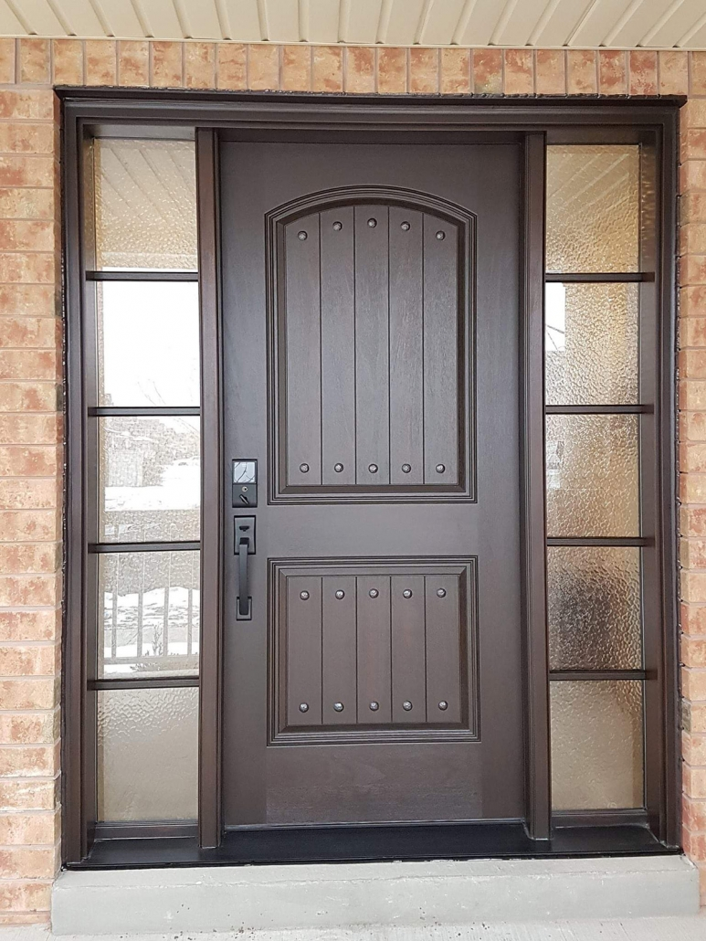 Mahogany front door in Stouffville with camber plank door slab and sdl grills