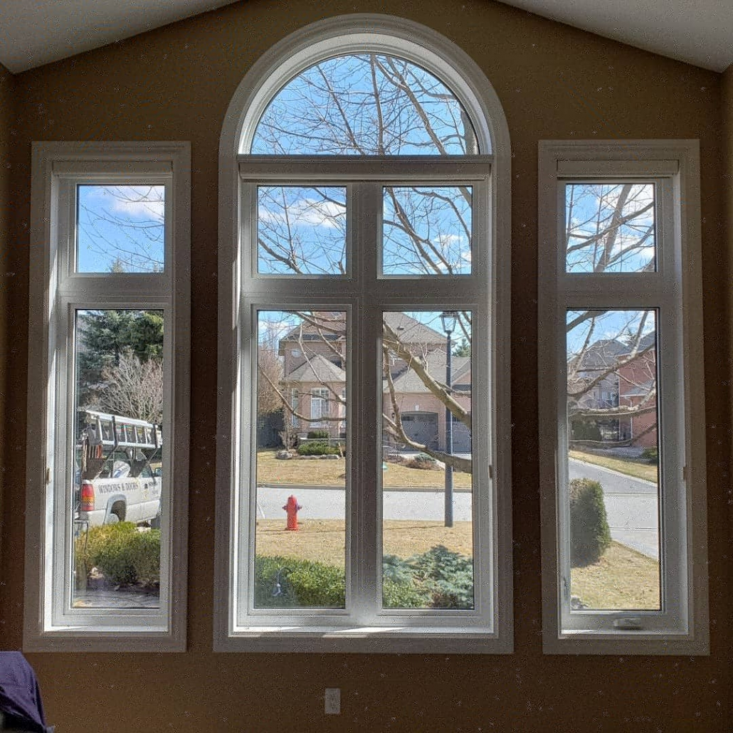 Finished installation of new windows in Aurora with primed colonial style trim